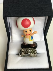 Toad posing with the ring